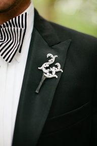 2013 Wedding Trend | Black Details - Black + white boutonniere #black #menswear  #weddingtrend #weddings