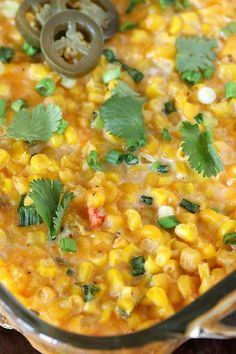 Cheesy Fiesta Corn Casserole in Baking Dish Topped with Chopped Cilantro and Jalapenos Image Mexican Corn Casserole, Baked Corn Casserole, Veggie Casserole, Easy Casserole Recipes, Casserole Dishes, Veggie Side Dishes, Vegetable Dishes, Side Dish Recipes, Homemade Lasagna Recipes