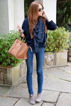 I'm not usually a fan of navy with blue jeans but the grey booties and tan bag make this outfit work. Notice it's another structured bag.