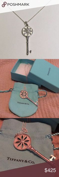 New listing: Tiffany daisy key necklace Silver daisy key pendant necklace 22 inch chain 6 inch pendant with brilliant center diamond brand new never worn comes with pouch and box as shown Tiffany & Co. Jewelry Necklaces