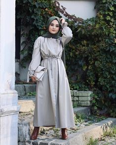Image may contain: 1 person, standing and outdoor Modern Hijab Fashion, Modesty Fashion, Abaya Fashion, Muslim Fashion, Fashion Outfits, Fashion Muslimah, Women's Fashion, Hijab Wedding Dresses, Hijab Dress