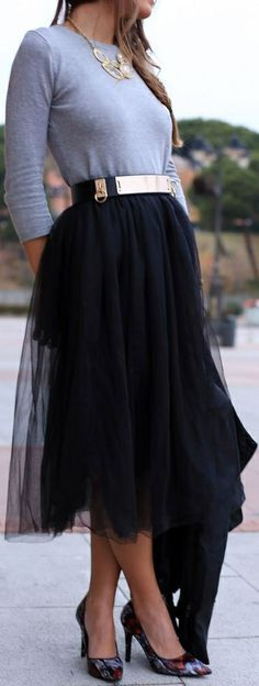 Black tulle midi skirt. Love it with the gold accents and belt.