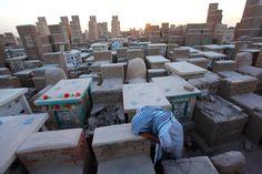 A man grieves at a cemetery in Najaf, south of Baghdad :: REUTERS/Alaa Al-Marjani The week's best photojournalism - The Week