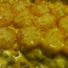 Tatertot Casserole 2 lbs hamburger meat browned and drained, 1 can cream of chicken soup, and 1 can cheddar cheese soup. Mix well. Pour into 9x13 pan. Cover with shredded cheddar cheese. Top with tatertots. Bake in 400 degree oven for 35-40 mins, or until tatertots are browned.