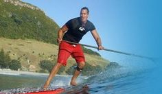 Eastcoast SUP Paddler. Stand up paddle board and surfing at Mount Maunganui, Bay of Plenty, New Zealand