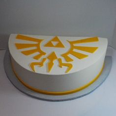 My Step daughter would love this. Zelda Cake with Triforce