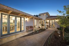 Love the lights on house, much warmer and inviting looking, north facing garden North Facing Garden, Newport, Building Design, French Doors, Mansions, Interior Design, Architecture, Street, House Styles