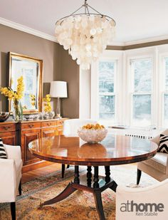Chandelier made of capiz shells lends a modern touch to this traditional dining room