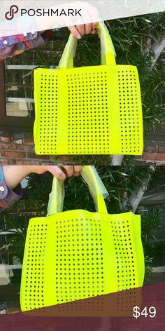 Un Billion Perforated Moeko Mini Tote Highlighter Yellow Perforated Mini Tote by Un Billion NYC. #unbillion #moeko #unbillionnyc Un Billion Bags Totes