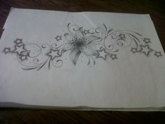 lily tattoo design with swirls and stars by *tattoosuzette on deviantART