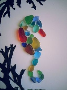 'Seahorse'. This beautiful rainbow coloured seaglass was beach combed from Seaham by GreenFox Floral Art .