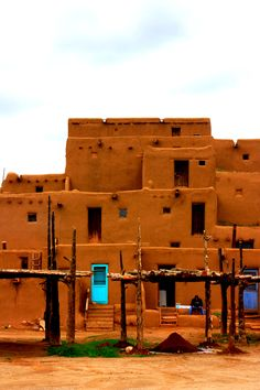 Taos Pueblo, Taos, New Mexico - on a cloudy day for very wonderful contrasts, loved the turquoise door