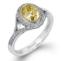 Passion Collection - This gorgeous 18K white and yellow gold engagement ring is comprised of .31ctw round white Diamonds.  - MR2347