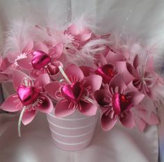 Pink origami flowers with a heart shaped chocolate centre. Mmmm