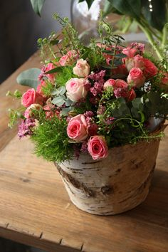 Birch/Aspen bark containers with a sweet pink spray rose with trick dianthis arrangement.