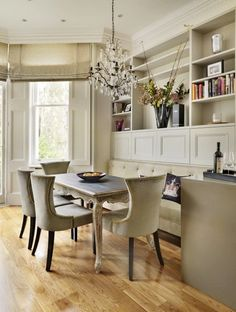 love banquettes....airy, white dining