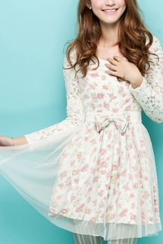 The dress made of cotton and polyester, featuring round neck, long sleeves, flower print to main, bound waist with bowknot embellishment, gauze top, contrast lace panel to upper side, all in regular fit.