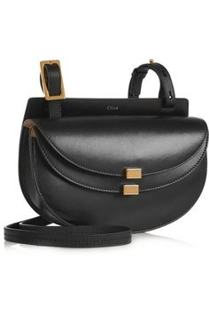 Black leather (Calf) Snap-fastening front flap Comes with dust bag Weighs approximately 1.5lbs/ 0.7kg