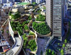 Built in the footprint of the old Osaka baseball stadium, Namba Parks is a shopping mall with an eight level rooftop garden that spans several city blocks and features tree groves, rock clusters, cliffs and canyons, lawns, streams, waterfalls, ponds and even space to grow veggies!