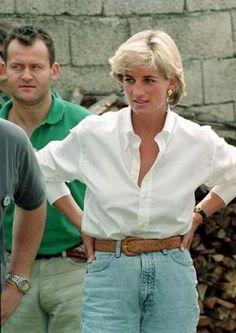 August 9, 1997: Diana, Princess of Wales, and her butler, Paul Burrell (green shirt), meeting Bosnian Serbs and Muslims affected by landmines near Tuzla during the second day of her visit to Bosnia.
