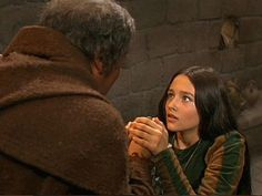Romeo-Juliet-1968 Begging Friar  Lawrence for help in evading the odious advances and marriage proposal of Counte Paris