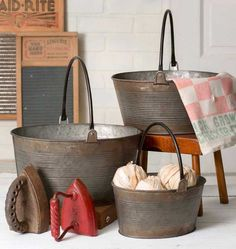 Set of Three Round Buckets with Handles Handles fold flat and buckets nest for easy shipping and storage. Excellent for a variety of uses and spaces--throw blankets, toss pillows, potatoes, kindling!  Large: 13