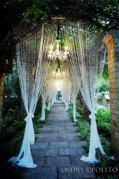 Lace curtained garden walkway or aisle for a garden wedding