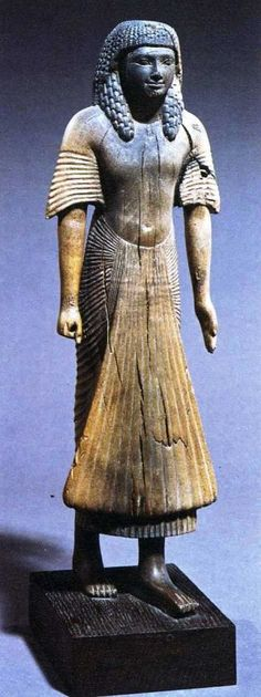 Statue of an unnamed administrator, wood, 29.2 cm; Dynasty XVIII; the garment was probably linen, and shows the pleats popular at the time. British Museum, London, U.K.