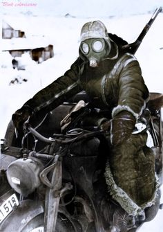 German soldier on the Eastern front with his motorcycle. Cold winter..