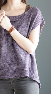 Jessie's Girl is a drapey, oversized sleeveless pullover, perfect to throw over a tank in the warmer months. It's a seamless, easy knit that is worked from the bottom up and features a slightly longer back to help create the drapey silhouette.