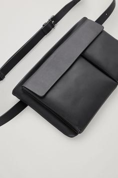 Designed from smooth leather, this belt bag is a stylish addition to any daytime look. - Narrow belt-style strap - A zipped main compartment - A front flap pocket with discreet magnetic fastenings Cow leather x Vintage Leather Messenger Bag, Leather Belt Bag, Black Leather Bags, Leather Men, Black Bags, Ladies Leather Bags, Tote Bags, Belt Bags, Duffle Bags