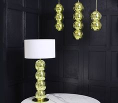 Rondo Pendants and Table Lamp