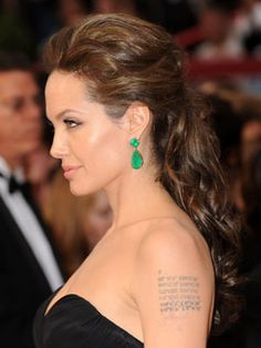Angelina Jolie, 2009  Angie often opts for simple styles on the red carpet. But we love when she does a little something extra like with this half-up 'do — complete with the perfect earrings.
