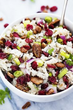 Cranberry Pecan Wild Rice Salad - A tasty fall salad with wild rice, red onions, crunchy pecans, tart cranberries, and a sweet dressing!