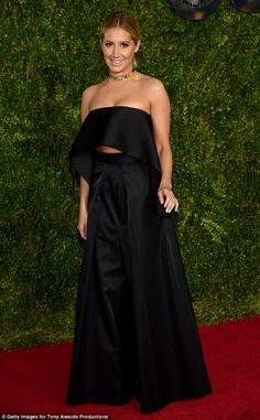 Simply stylish: Ashley Tisdale ensured that she cut a stylish figure as she joined the goo...