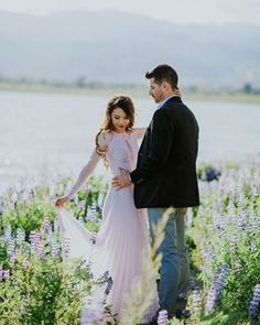 We fell head over heels for this engagement shoot at first sight! That lavender dress that lupine field = Head to the link in our bio to see it all! and shop her dress too!) Photo by Engagement Announcement Photos, Field Engagement Photos, Engagement Dresses, Engagement Shoots, Engagement Inspiration, Photoshoot Inspiration, Engagement Ideas, Photoshoot Ideas, Couple Photography