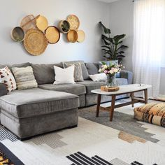 @eclectic.leigh on Instagram Boho living room, grey sectional sofa, boho cushions