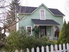 What Style Is It?: Restoring a Folk Victorian: This tidy little home appears to be a Folk Victorian, but what's the porch just isn't right.  The owners would like to restore their Victorian home and they wonder: What type of porch did the house used to have? What colors would be appropriate for this style Victorian? Does the house need more architectural trim?