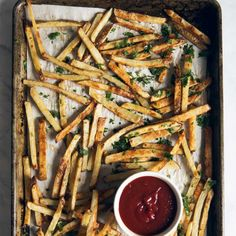 Healthy Baked French Fries with Garlic, Parmesan & Truffle Oil Recipe Side Dishes with olive oil cooking spray, russet potatoes, olive oil, truffle oil, garlic, garlic powder, sea salt, veggies, parmesan cheese, chopped cilantro, truffle oil, salt, pepper