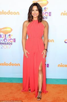 Stunning: She had complemented the orange carpet perfectly on arrival...