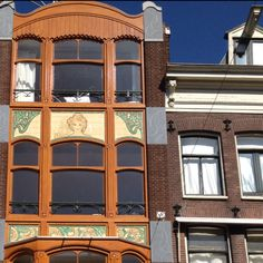 A lovely building on the Haarlemmerdijk in Amsterdam. Art Deco tiles with beautifully restored wooden window frames