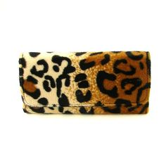 A sexy wallet a this price! You don't say.  Fuzzy Cheetah Wallet:Animal print AND fuzzy? Count me in! This is an adorable wallet that can also be used as a clutch bag. It's so cute, why would you want to hide it? The outside is fuzzy animal print, the inside is black with two long slots for bills and six slots in the center for cards. Closed it measures 7.5 inches...