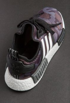 """Detailed photos of the BAPE x adidas NMD R1 collaboration have finally surfaced, and the release is looking to be another instant classic in the history of streetwear collaborations. Arriving in two seperate colorways of """"Green Camo"""" and """"Purple Camo,"""" A Bathing Ape's famous ape camomotif can be found on the uppers of both pairs. …"""