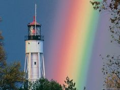 Two of my favorite things; lighthouses and rainbows....beautiful