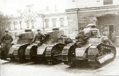 The Renault FT was a French light tank produced from 1917. It was the first operational tank with its armament in a fully rotating turret, and its configuration with the turret on top, engine in the back and the driver in front