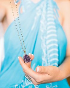 """As a token of appreciation and love, the bride made necklaces for each of her bridesmaids using different crystals."""