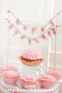 love the mini banner above the cupcakes!  AND the little upside down glass jar in the middle to make the princess' cupcake stand out.