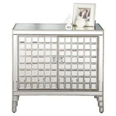 """Mirrored chest with grid motif.  Product: ChestConstruction Material: Mirrored glass and woodColor: SilverFeatures: Will enhance your spaceDimensions: 30"""" H x 33"""" W x 18"""" D"""