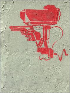 This political graffiti message, in my interpretation, shows that the security we have that is supposed to protect and help us, actually gets us in trouble for little things, and also is how we focus on our information when it comes to official issues because we always need to have proof as our weapon.