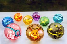 The pokeballs of #Eevee and Eeveelutions. #art #pokemon #photography #colorful